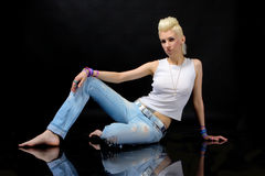 Beautiful Blonde Girl In Jeans Stock Photography