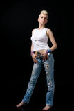 Beautiful blonde girl in jeans Royalty Free Stock Image