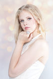 Beautiful blonde girl with jewelry Royalty Free Stock Photography