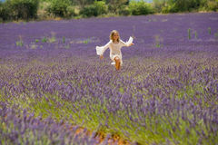 Beautiful blonde girl jumps in lavender field Stock Images