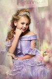 Beautiful blonde girl in a lavender dress Royalty Free Stock Photos