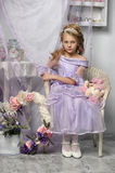 Girl in a lavender dress Stock Photo