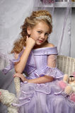 Girl in a lavender dress Stock Images