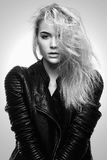Beautiful blonde girl in leather coat Royalty Free Stock Photography