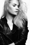 Beautiful blonde girl in leather coat Stock Images