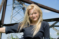 Beautiful blonde girl lies on a construction site Royalty Free Stock Photography