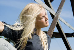 Beautiful blonde girl lying on the iron Stock Photos