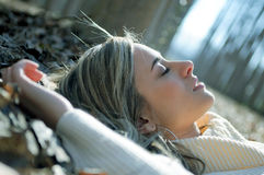 Beautiful Blonde Girl Lying On Leaves Stock Photos
