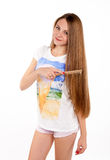 Beautiful blonde girl makes the hairstyle Royalty Free Stock Images