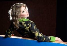 Beautiful blonde girl in military khaki shirt Stock Images