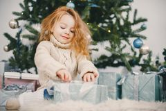 Beautiful blonde girl opening gifts stock images