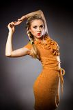 A beautiful blonde girl in orange dress Stock Photography