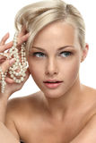 Beautiful blonde girl with Pearl beads Stock Photography