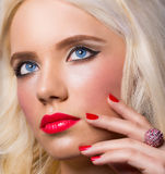Beautiful blonde girl with perfect makeup and manicure Royalty Free Stock Photo