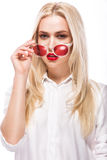 Beautiful blonde girl in pink glasses and shirt. Beauty face. Isolated on white background. Stock Images