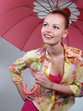 Beautiful blonde girl with pink umbrella Royalty Free Stock Photography