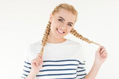 Beautiful blonde girl. Portrait of beautiful blonde girl smiling at camera isolated on white stock photo