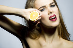 Beautiful blonde girl portrait with orange Royalty Free Stock Image