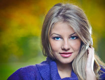 Beautiful blonde girl posing in a autumn forest Stock Photo