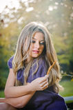 Beautiful blonde girl posing in a autumn forest Royalty Free Stock Images