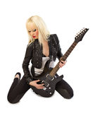 Beautiful blonde girl posing with black guitar Royalty Free Stock Photos