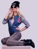 Beautiful blonde girl posing. On grey background stock photography