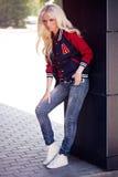 Beautiful blonde girl in posing Stock Images