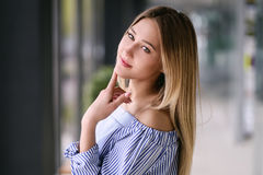 Beautiful blonde girl posing portrait indoors Stock Photography