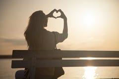 Beautiful blonde girl posing at sunny day. Royalty Free Stock Photo
