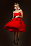 Beautiful blonde girl in a red dress Stock Photos