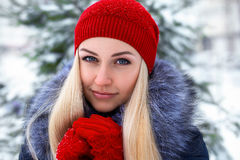 Beautiful blonde girl in red hat and gloves Royalty Free Stock Photos