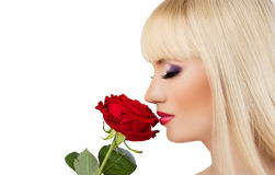 Beautiful blonde girl with red rose Stock Photo