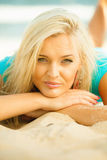 Beautiful blonde girl relaxing on beach Stock Photo