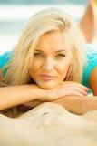 Beautiful blonde girl relaxing on beach Stock Photo