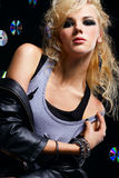 Beautiful blonde girl rocker Stock Images