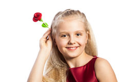 Beautiful blonde girl with rose in hair. Isolated over white background stock images