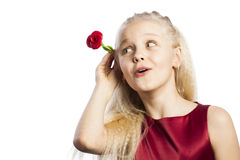 Beautiful blonde girl with rose in hair. Isolated over white background royalty free stock image