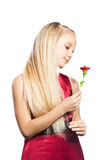 Beautiful blonde girl with rose. Isolated over white background stock photography