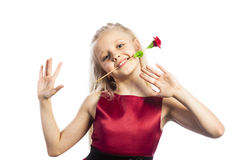 Beautiful blonde girl with rose in mouth. Isolated over white background stock image