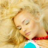 Beautiful blonde girl on sandy beach, portrait Stock Image