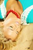 Beautiful blonde girl on sandy beach, portrait Royalty Free Stock Photo