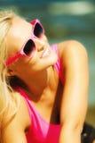 Beautiful blonde girl on sandy beach, portrait Stock Photo