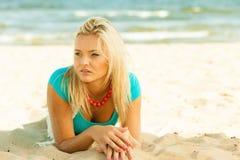 Beautiful blonde girl on sandy beach, portrait Stock Photography
