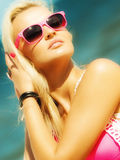 Beautiful blonde girl on sandy beach, portrait Royalty Free Stock Photos