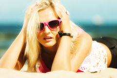 Beautiful blonde girl on sandy beach, portrait Royalty Free Stock Photography