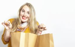 Beautiful blonde girl with shopping bags royalty free stock photography
