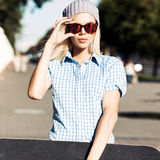 Beautiful blonde girl in short shorts with skateboard Royalty Free Stock Photo