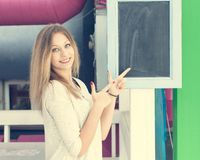 Beautiful blonde girl showing thumbs up on a board outdoor Royalty Free Stock Images