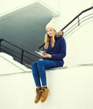 Beautiful blonde girl sitting using digital tablet pc Royalty Free Stock Photography