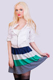 Beautiful blonde girl in skirt with stripes Stock Photo